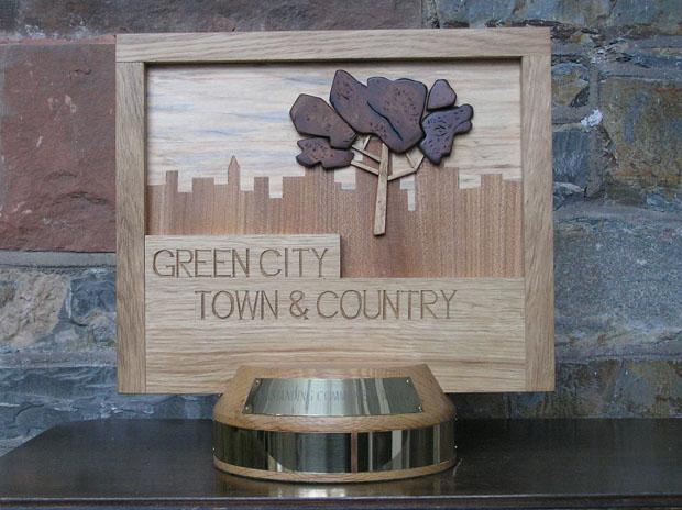 award, solid oak, hand carved, sculpture, trophy, bespoke design, custom made, unique award,